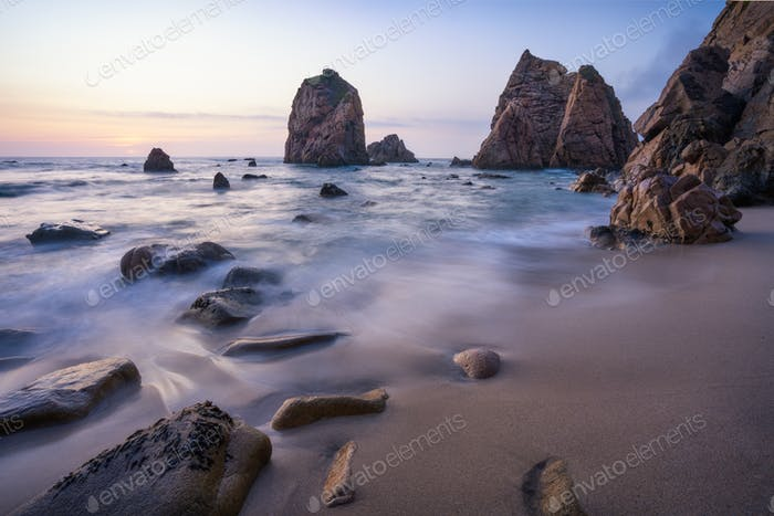 Ursa Beach beautiful coast with sea stack at sunset, Portugal. Atlantic Ocean. Holiday vacation