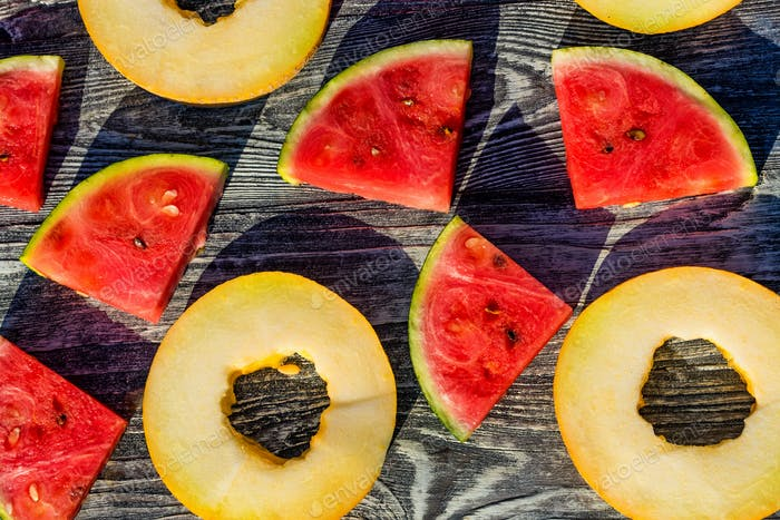 Slices of melon and watermelon close up background