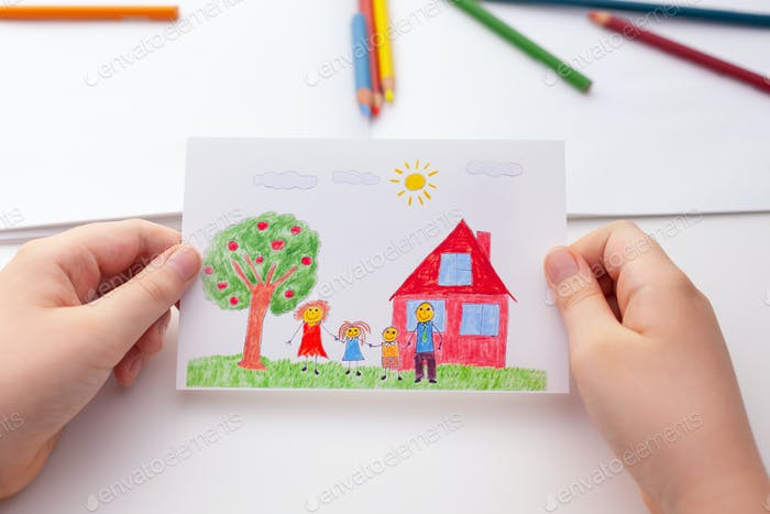 Child holding a drawing with a happy family and an apple tree and a house