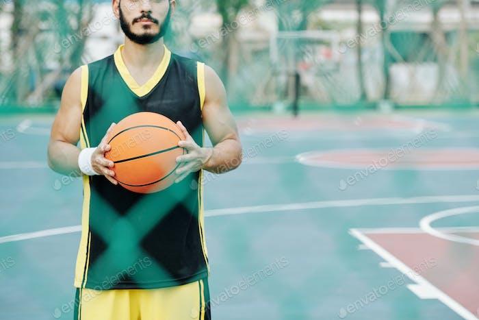 Basketball player holding ball