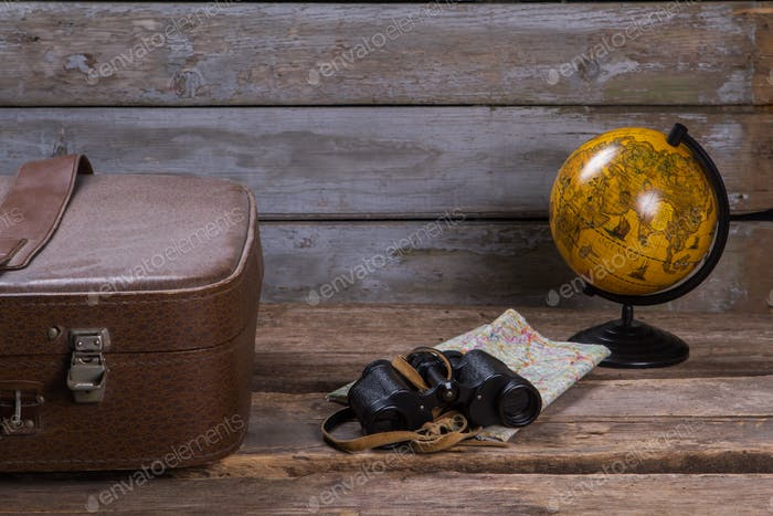 Globe with map and binoculars.