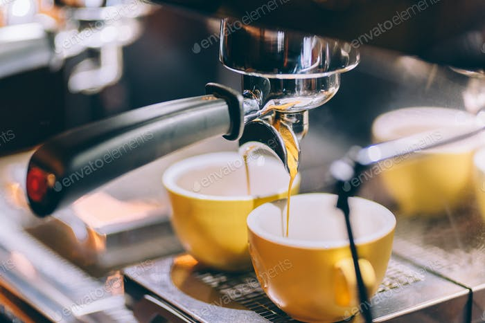 Professional brewing - coffee bar details. Espresso coffee pouring from espresso machine