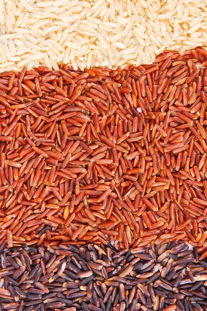 Brown, black and red rice as background, healthy gluten free food concept