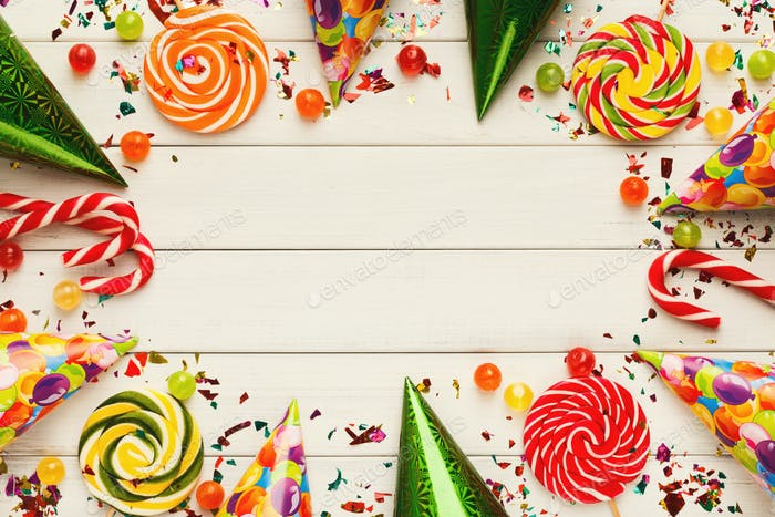 Colorful balloons on white rustic wood, birthday background, top