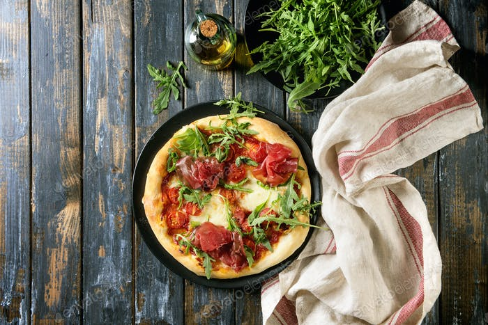 Homemade pizza with bresaola