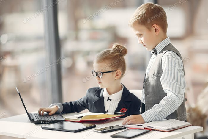 Children at the office with a laptop