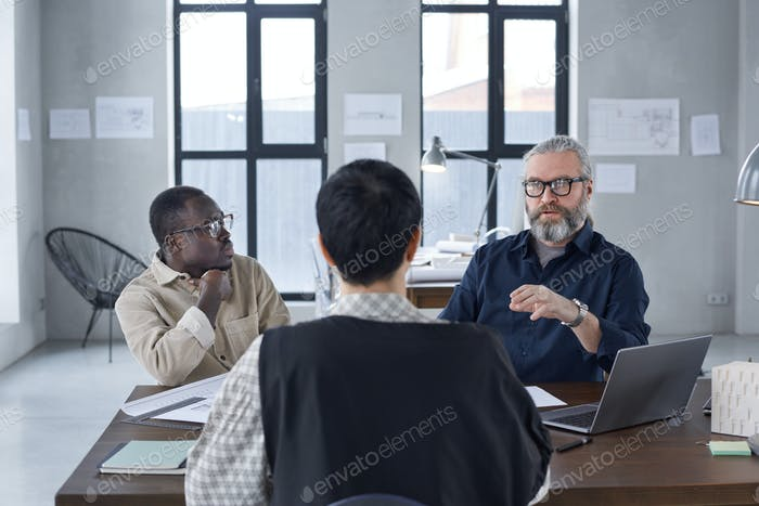 Business people sitting at director's office
