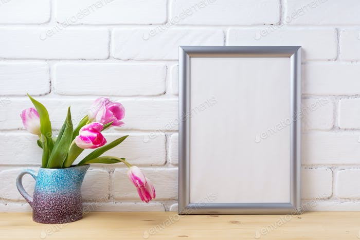 Silver frame mockup with pink tulip in purple blue vase