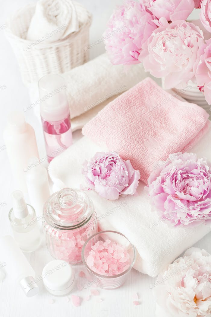 bath and spa with peony flowers beauty products towels