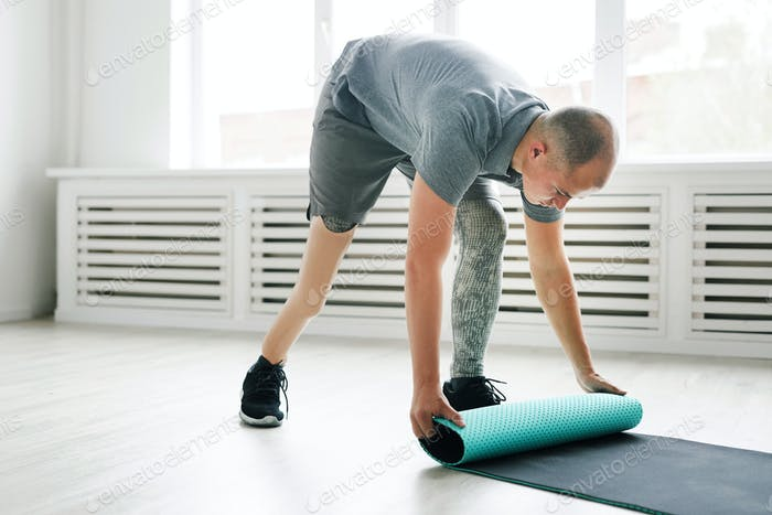 Man with exercise mat