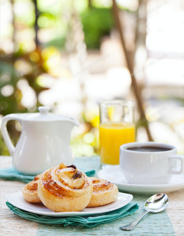 Romantic tropical breakfast Danish pastry, coffee, juice. Summer background