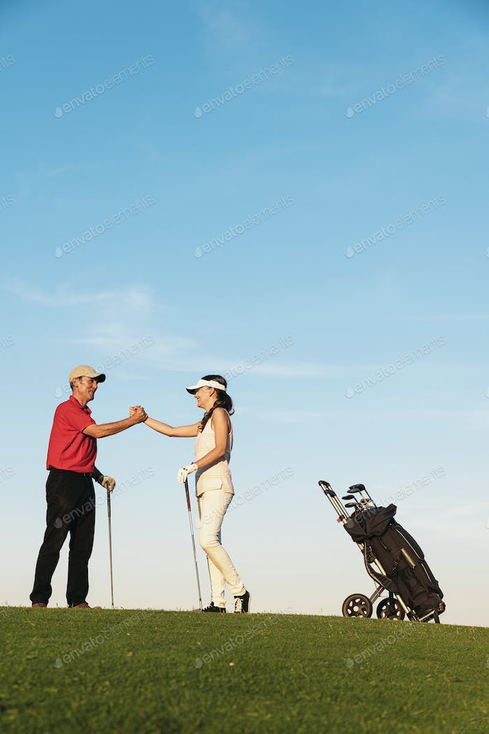 Golfer and Caddie playing golf.