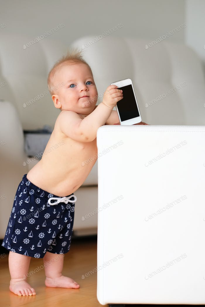 Baby boy playing with phone