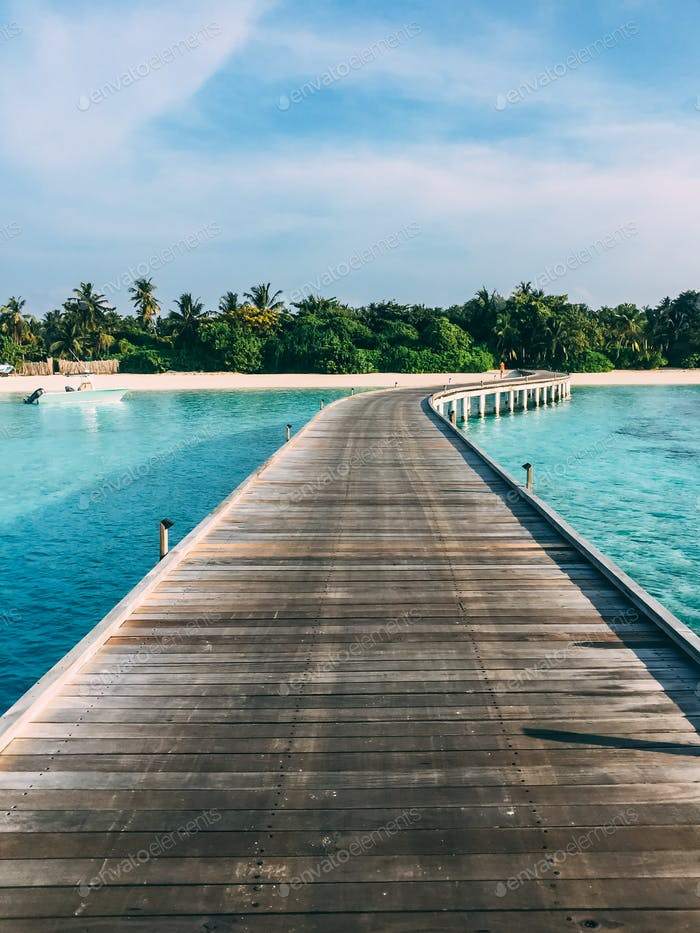 Maldives island luxury resort wooden pier