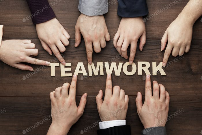 Thumbnail for Teamwork Concept On The Brown Wooden Table Background