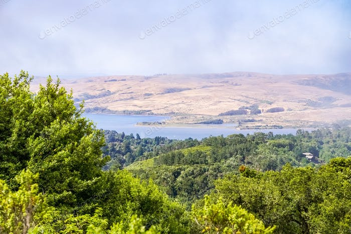 View of the Point Reyes National Seashore estuaries through fog from the hiking trails, California