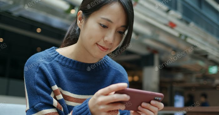 Woman play game on cellphone