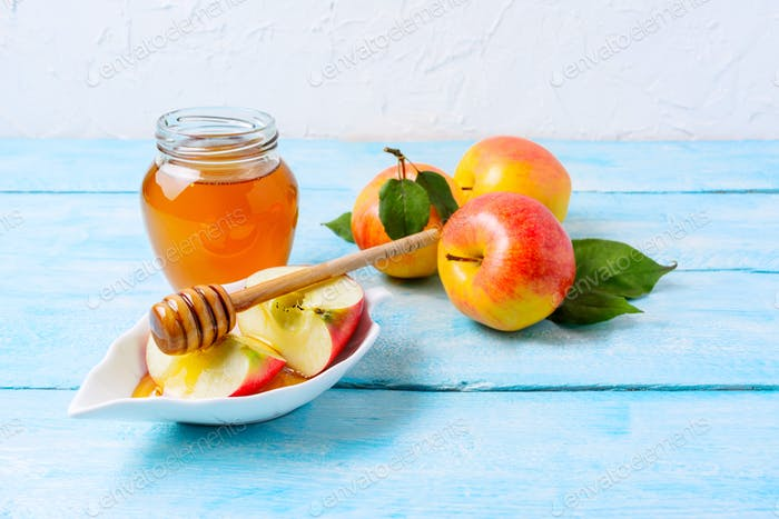 Honey jar and apple slices, copy space