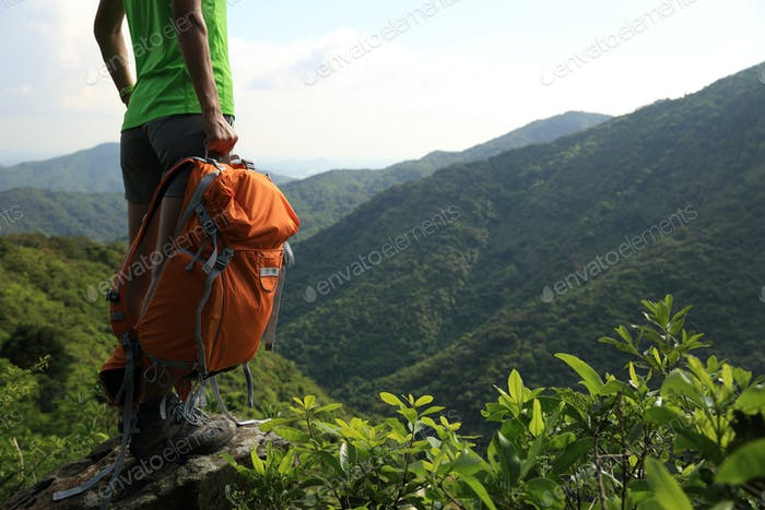 Hiker with backpack in the nature