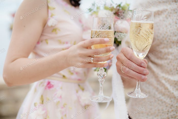 wedding couple holding glass champagne
