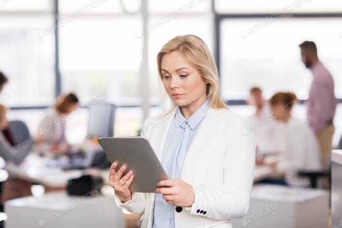 businesswoman with tablet pc computer at office