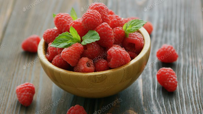 Fresh raspberry on wooden table