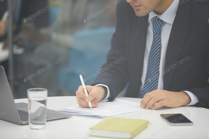 Unrecognizable Businessman Writing