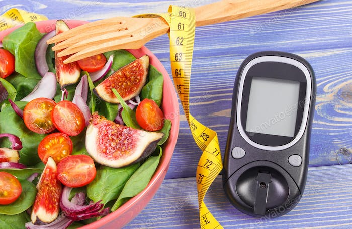 Fruit and vegetable salad, glucose meter for measurement sugar level and tape measure