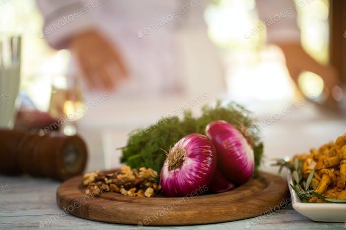 Purple onions on wooden board