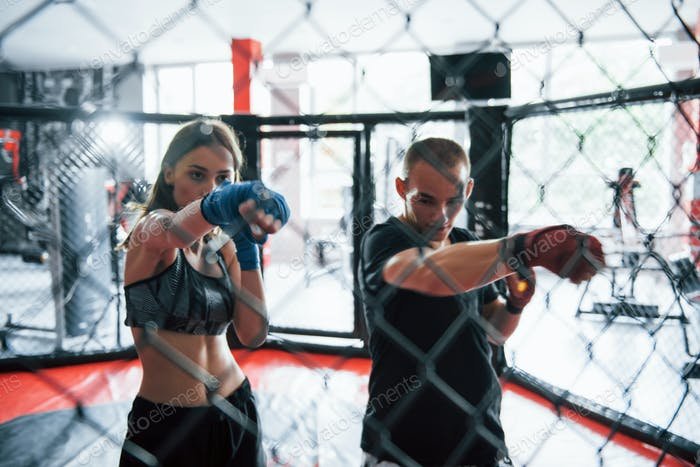 Athletic young people have daily exercise on the boxing ring