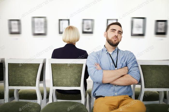 Pensive Man in Art Gallery