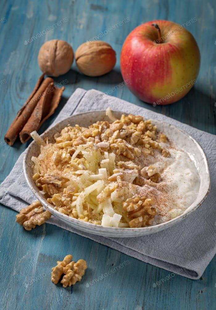 Grated apple with walnut and yogurt