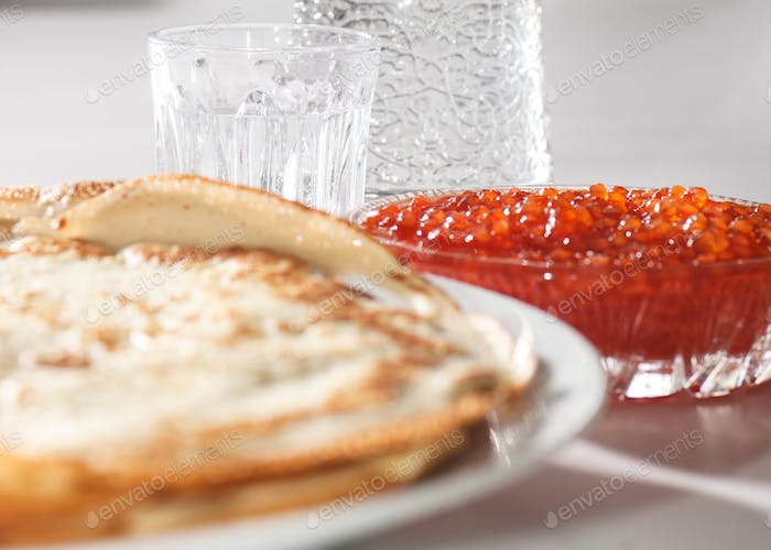 crepes, red caviar and vodka