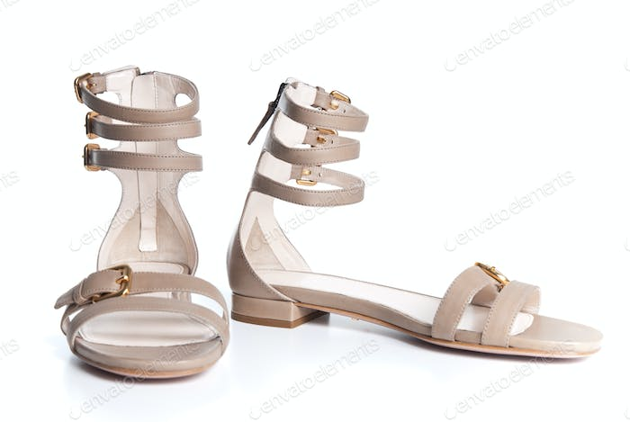 beigeleather female sandals isolated on white
