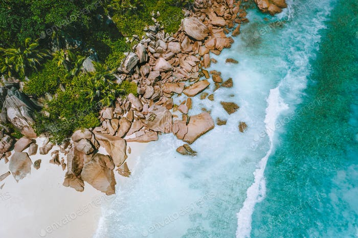 Aerial view of Seychelles tropical paradise Grand Anse beach at La Digue Island with crystal clear