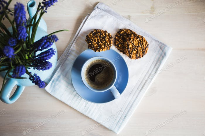 A cup of coffee with flowers and cookies. Vintage