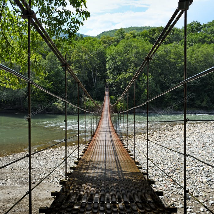 Suspension bridge through river Belaya in Republic of Adygea, Russia