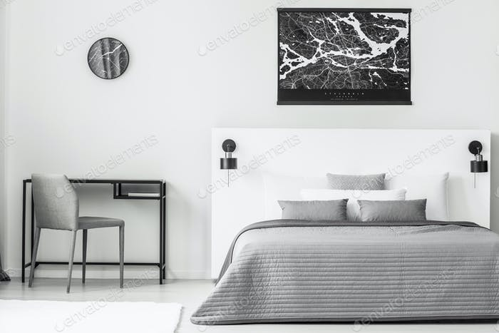Black poster in bedroom interior