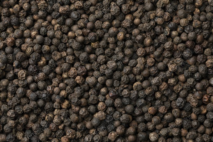 Black peppercorns close up full frame