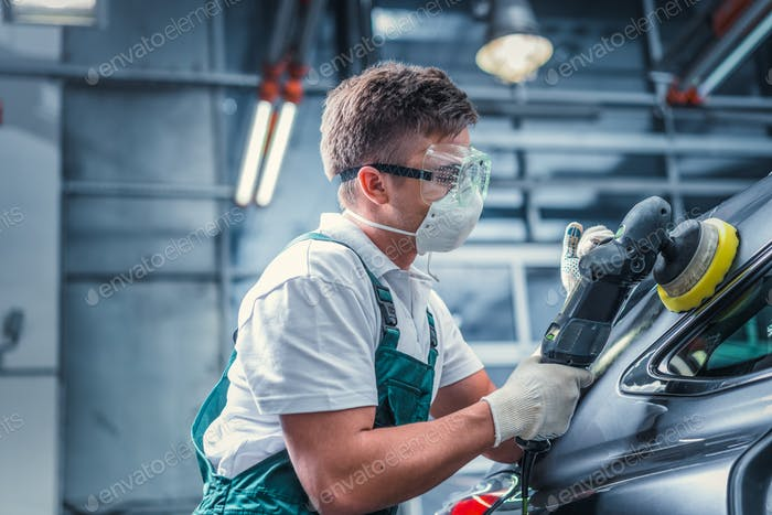 Worker in overalls