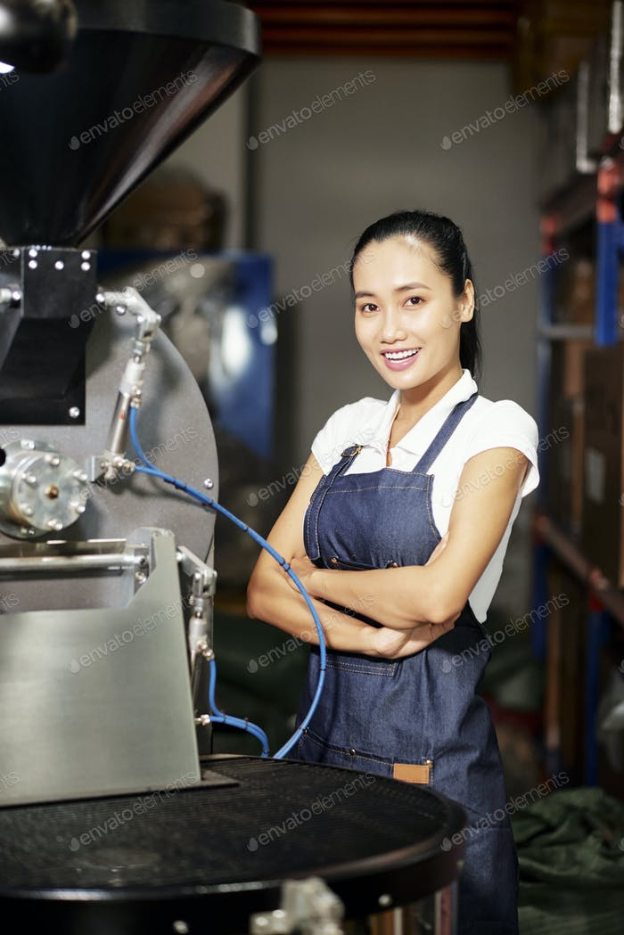 Woman operating professional roaster