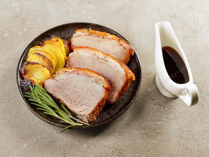 roasted pork slices and potatoes