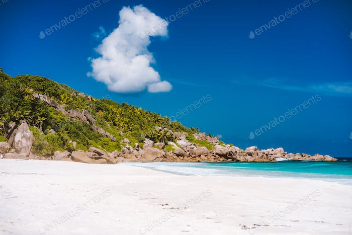 Holiday vacation on Petite Anse sandy tropical paradise beach on La Digue island, Seychelles. Travel
