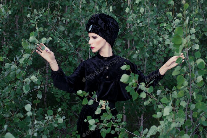 portrait of elegant woman in the forest