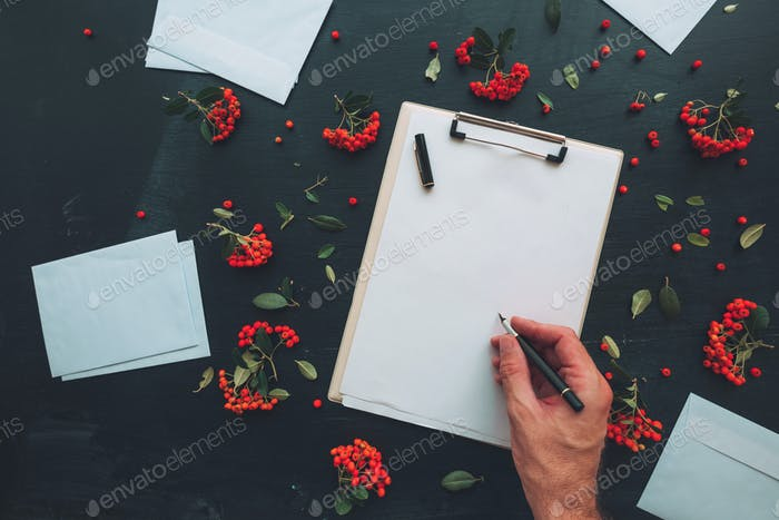 Flat lay hand writing letter