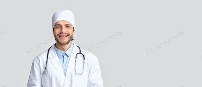 Professional medical doctor in uniform smiling at camera