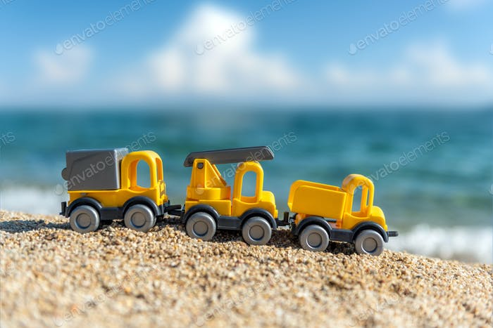 Children's toy car on the seashore