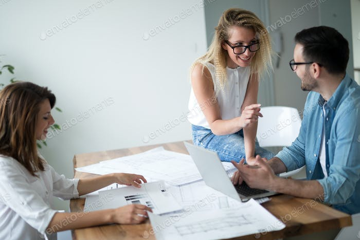 Coworkers discussing new ideas and brainstorming in a modern office