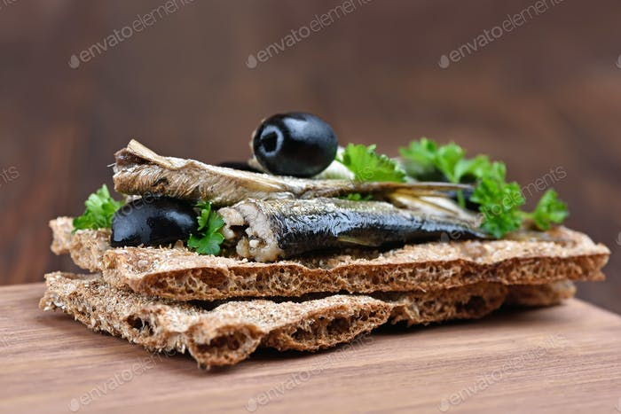 Fish sandwich with sprats on crispbread