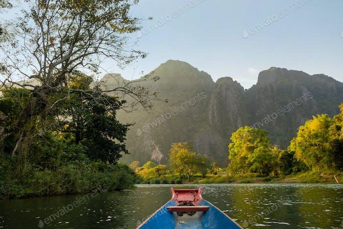 Nam Song River, a boat on the water at Vang Vieng, Laos